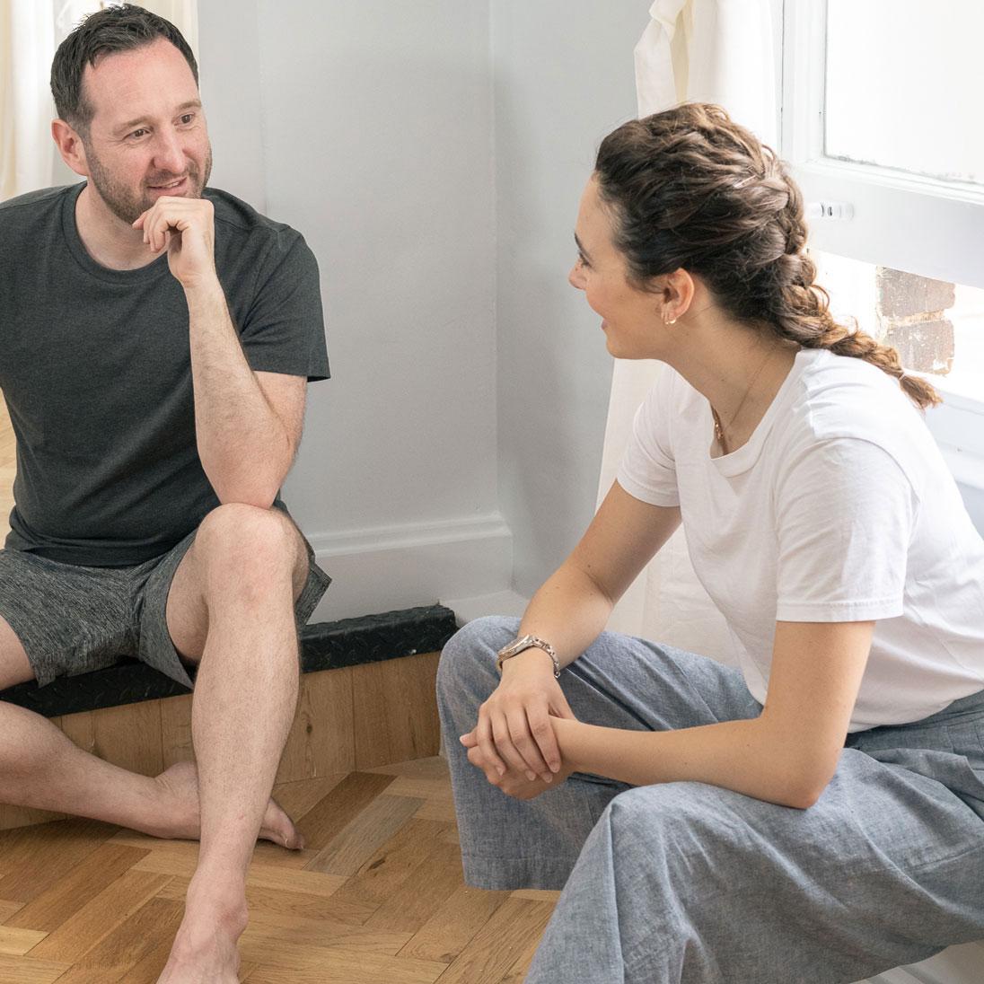 people chatting in yoga studio - contact complete yoga studio putney